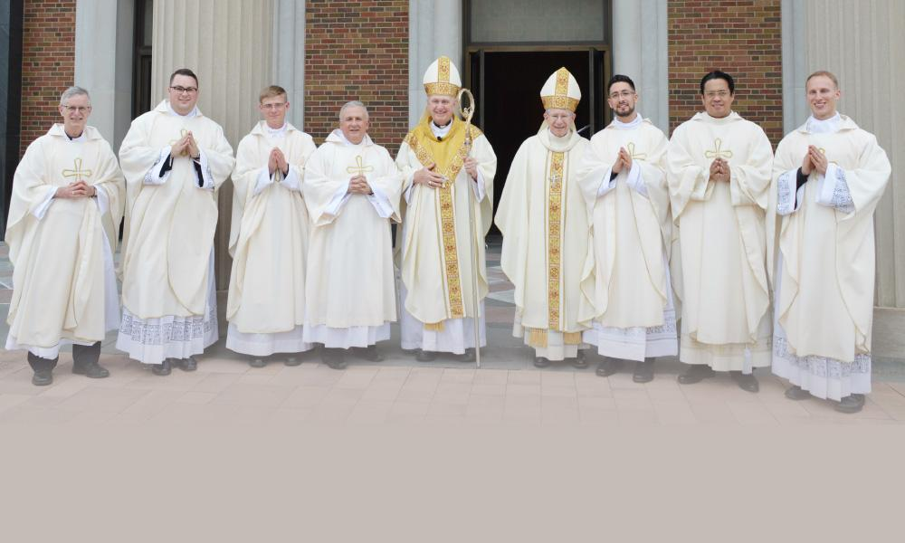 Six new priests and a transitional deacon